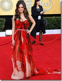 Actress Mila Kunis arrives at the 17th Annual Screen Actors Guild Awards held at The Shrine Auditorium on January 30, 2011 in Los Angeles, California.
